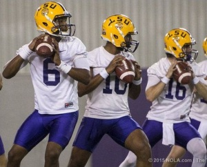 (l to r) Brandon Harris, Anthony Jennings, and Brad Kragthorpe practice in the LSU indoor facility.