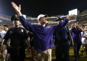 Les Miles receives the crowd's blessing after the game.